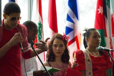 Students in the Intercultural Choir Sing Waving Flag